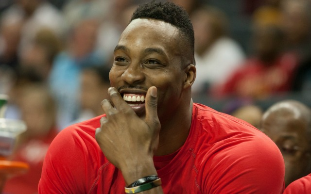 Dwight Howard smiles while thinking about his pet snakes.