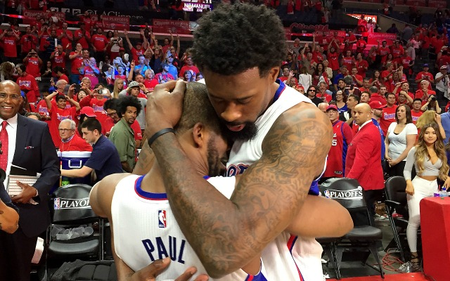 Chris Paul and DeAndre Jordan hug it out.