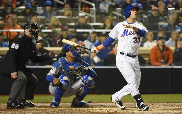 Michael Conforto opened the scoring with a solo homer in Game 4.