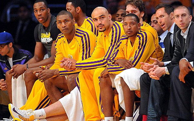 World Peace (second from left) played just 17 minutes in the Lakers' Game 3 loss to the Spurs. (USATSI)