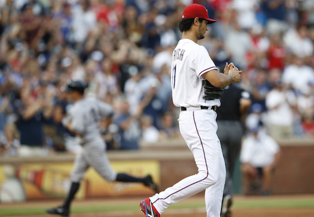 Yu Darvish (foreground) knows whom to blame for the success of Brett Gardner (background). (USATSI)