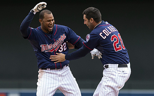 Aaron Hicks celebrates his walk-off single with Chris Colabello.