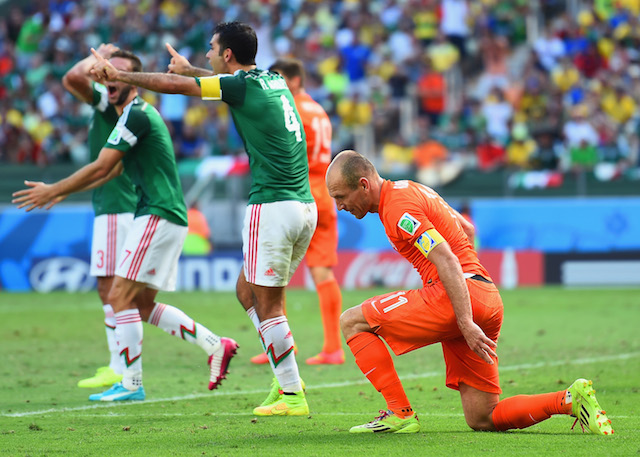 The reaction after Arjen Robben drew a penalty in the final minutes. (Getty Images)