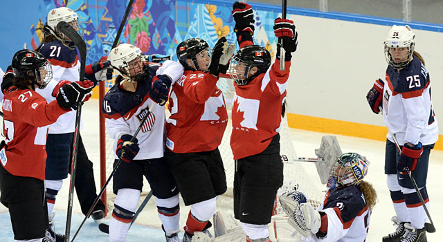 Hayley Wickenheiser celebrates after scoring a goal past USA's Jessie Vetter. (Reuters)