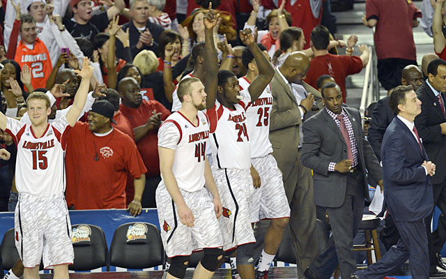 Playing it cool, Rick Pitino (right) believed in his Cards to make a run, and they came through. (USATSI)