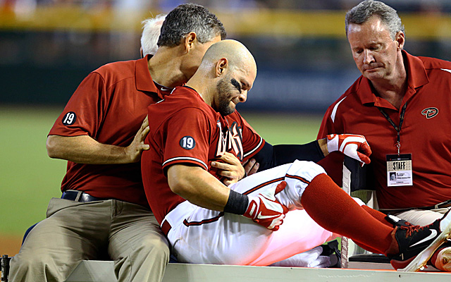 Cody Ross, being carted off the field Sunday with a dislocated hip.