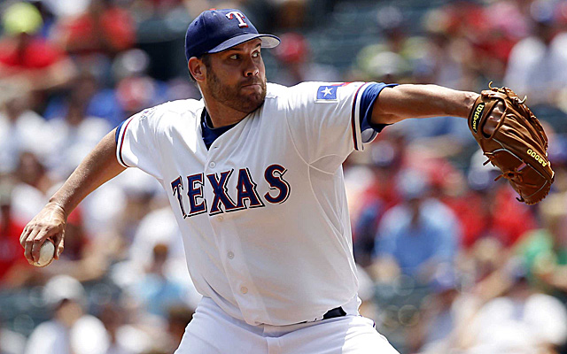 Colby Lewis is sticking with the Rangers.