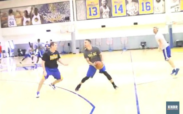 Curry tries to score in his new shooting drill.