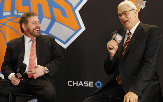 The fates of Phil Jackson (right, with James Dolan) and Derek Fisher will be tied to one another. (USATSI)