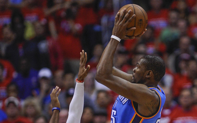 Kevin Durant can rise about Chris Paul's defense, but not a double-team. (USATSI)