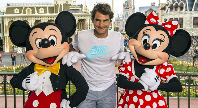 Roger Federer poses with Mickey and Minnie Mouse at the Magic Kingdom. (Provided)