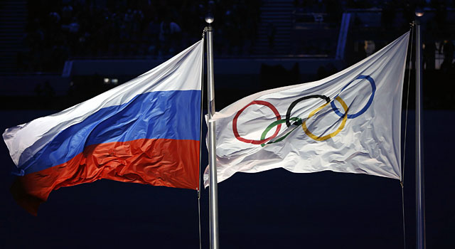 The Russian flag flies next to the Olympic flag. (Reuters)