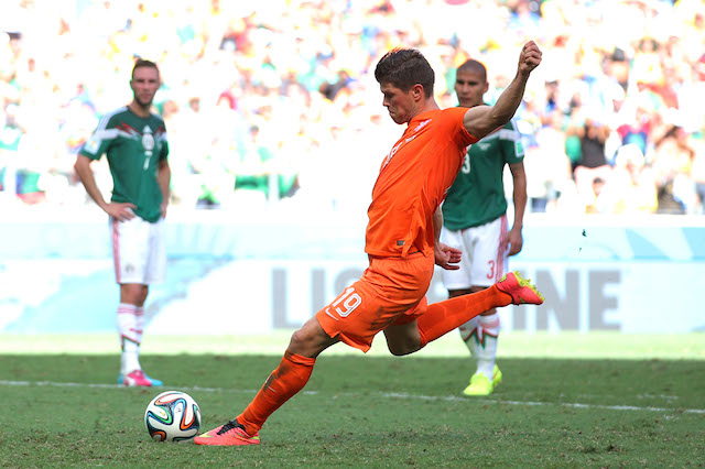 Klaas-Jan Huntelaar buries the match-winning penalty in stoppage time for the Netherlands. (Getty Images)