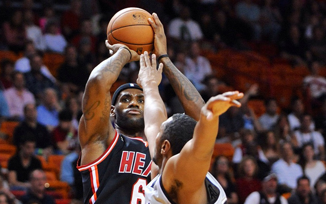 LeBron James and the Heat rose above the Spurs Sunday. (USATSI)