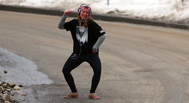 Kate Hansen enjoys dancing before going down the ice in the luge event. (Getty)