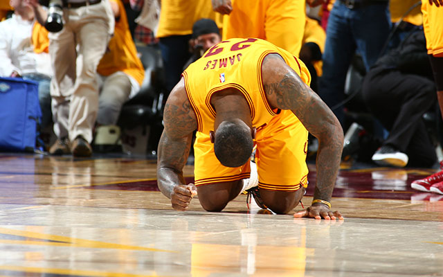 LeBron James collapsed with exhaustion after Game 3.  (Getty)
