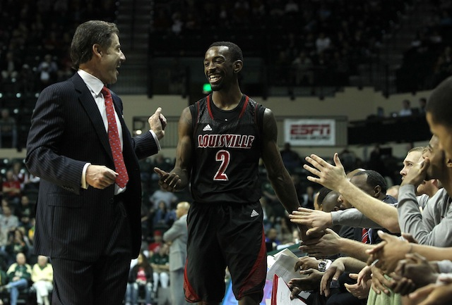 Rick Pitino and Russ Smith could have plenty more to smile about in 2013-14 season. (USATSI)