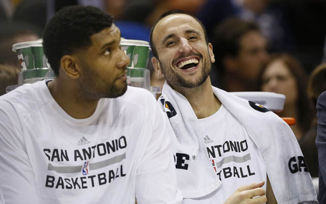 Manu Ginobili laughs at the birds' pitiful attempts to rob him. (USATSI)