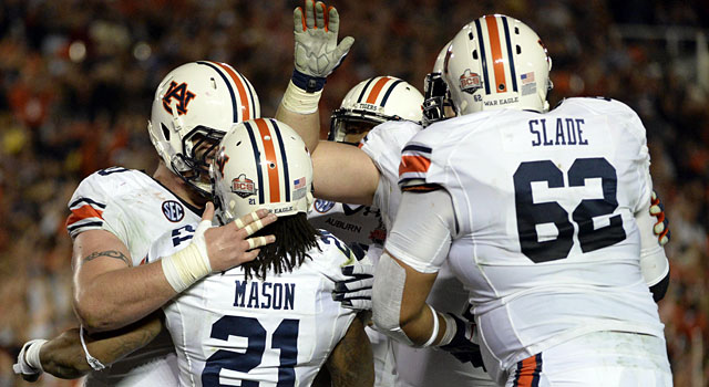 Auburn's Tre Mason celebrates with teammates after scoring the first TD of the game. (USATSI)
