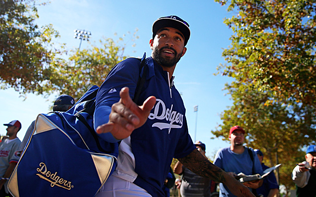 Matt Kemp arrives at camp, where he's not impressed with questions about possibly being the Dodgers' fourth outfielder.