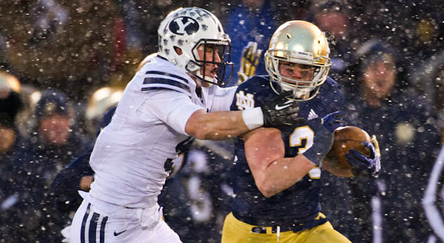 Cam McDaniel carries the ball as Alani Fua tries to bring him down. (USATSI)