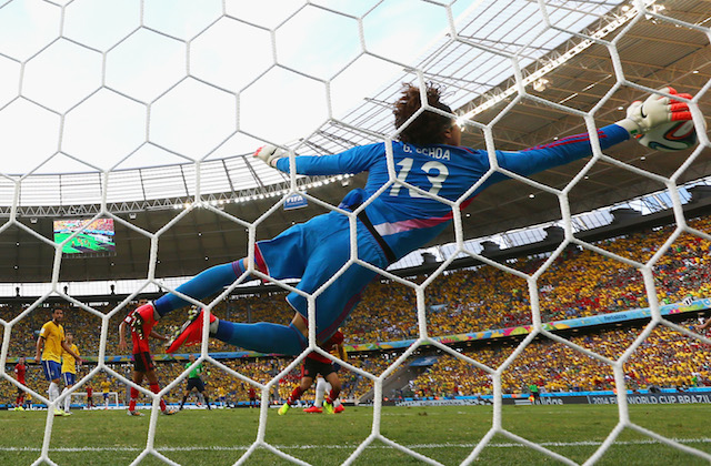 Guillermo Ochoa had the save of the tournament so far, denying Neymar's header. (Getty Images)