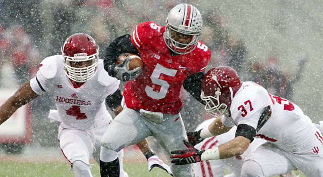 Braxton Miller breaks a tackle as the snow really starts coming down. (USATSI)