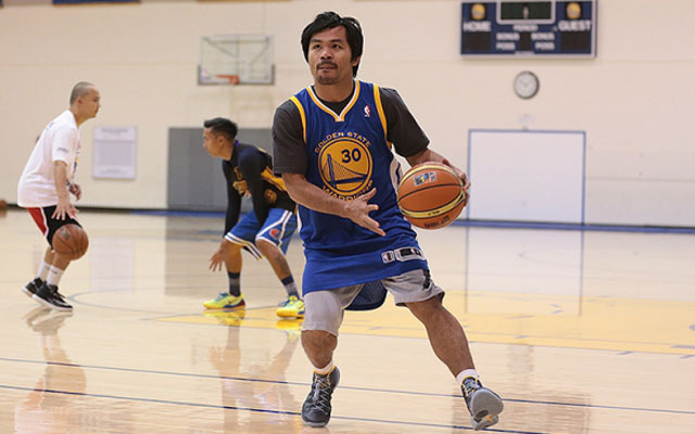 Manny Pacquiao hung out with the Warriors this week.  (USATSI)