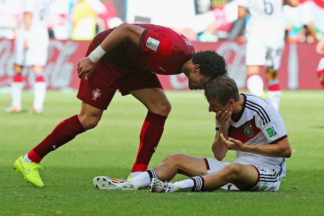 Possible turning point of Group G: Pepe headbutting Thomas Muller and earning a red card. (Getty Images)
