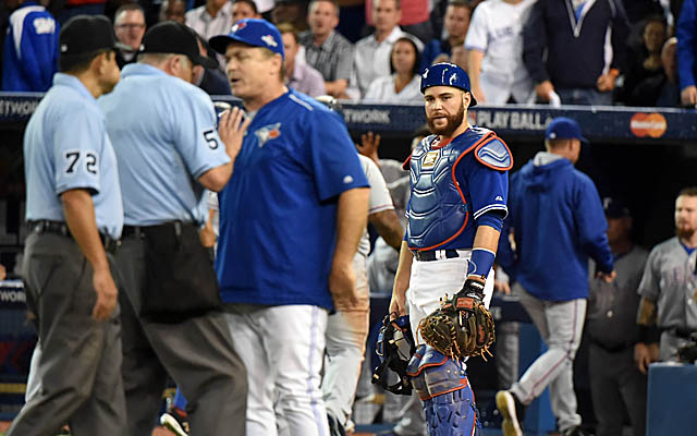 Russell Martin looks on while the umpires sort out the situation with John Gibbons.