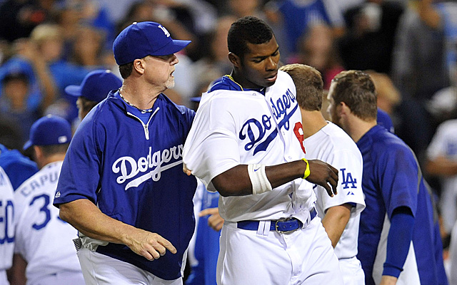 Yasiel Puig with hitting coach Mark McGwire during Tuesday's brawl.