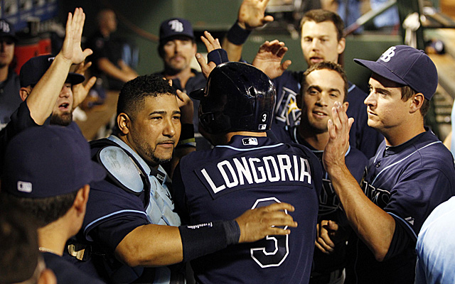 The Rays celebrate Evan Longoria's third-inning home run.