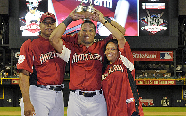 Robinson Cano with his parents after he won the Home Run Derby in 2011 with his Dad pitching.