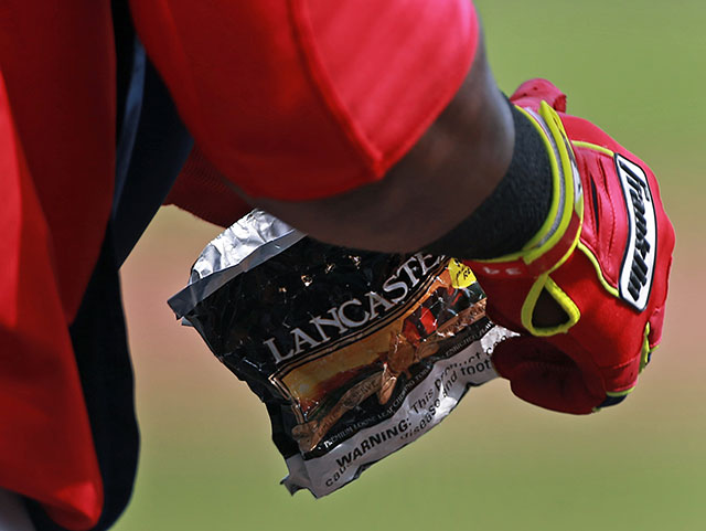 David Ortiz rips into a package of chewing tobacco.