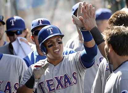 Speedster Leonys Martin scores twice for the Rangers, who remain 1 1/2 games out of first place in the AL West. (USATSI)