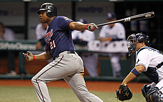 Minnesota's Delmon Young singles in the winning run in the 13th inning of the Twins' 2-1 win.  (AP)