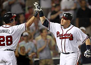 Eric Hinske (right) snaps an 0-for-17 skid with his go-ahead home run in the sixth inning. (AP)