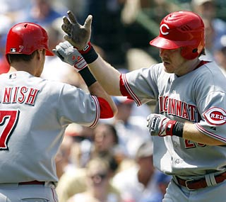 Ryan Hanigan hits a two-run homer in the second to get the Reds on the scoreboard.  (AP)