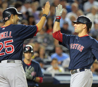 Ryan Kalish extends the Red Sox lead in the sixth inning with his first career home run.  (US Presswire)
