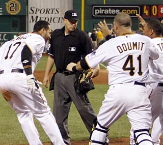 Pedro Alvarez completes a joyous trip to home plate after his walk-off shot in the bottom of the 10th.  (AP)