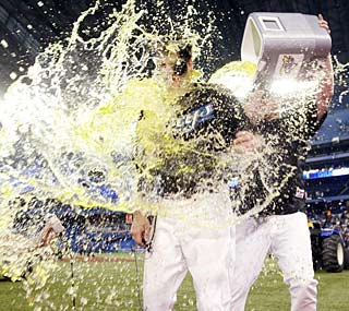 Toronto's Brandon Morrow gets doused after his 17-strikeout gem against the Rays.  (AP)