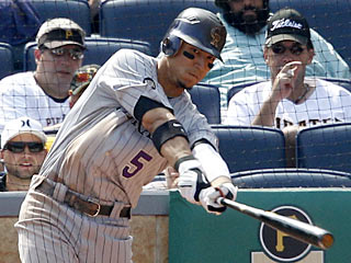 Carlos Gonzalez goes 4 for 5 with his eighth homer in 11 games as the Rockies pound the Pirates. (AP)