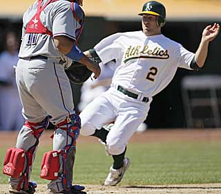 After a Coco Crisp double, Cliff Pennington slides in safely during the seventh to tie the game. (AP)