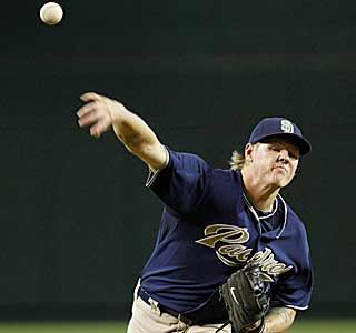 Mat Latos helps the Padres -- who had lost six of nine -- salvage a win against Arizona. (AP)