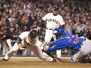 Travis Ishikawa tries to end the game in the 10th inning, but Koyie Hill tags him for the third out.  (US Presswire)