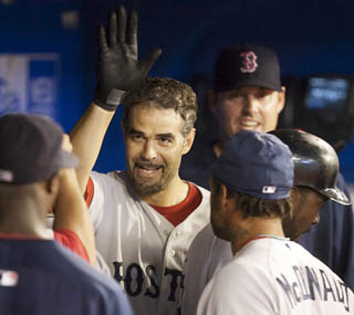 Mike Lowell gives the Red Sox the lead with his 8th-inning solo home run. (AP)