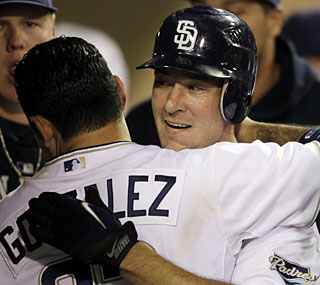 Ryan Ludwick gets a hug from Adrian Gonzalez after the new Padre hits his second homer of the night.  (AP)