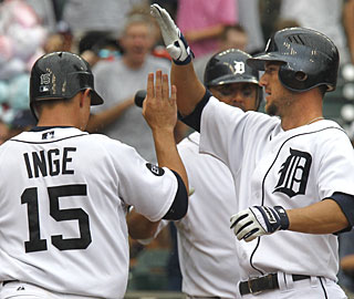 Ryan Raburn smacks a two-run homer in the sixth and his teammates let him know about it. (AP)