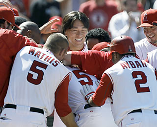 The Angels surround game hero Bobby Abreu, who drives in the winning run in the 10th inning.  (AP)