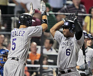 Melvin Mora and the Rockies take the lead with a grand slam with two outs in the eighth.  (AP)